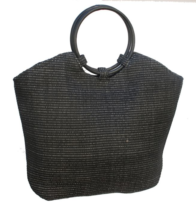 large black straw bag with bamboo handles